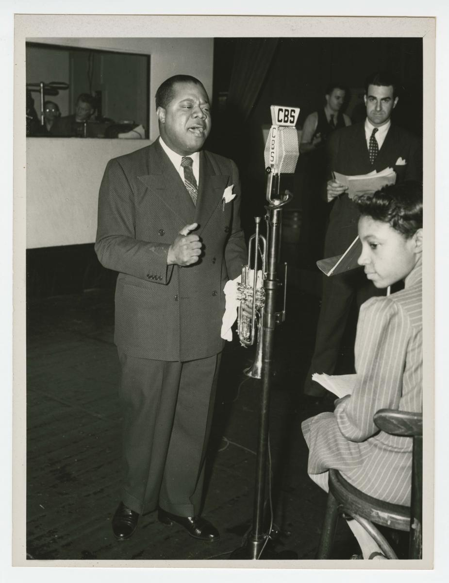 Photograph of Louis Armstrong recording at the CBS Studio in New York