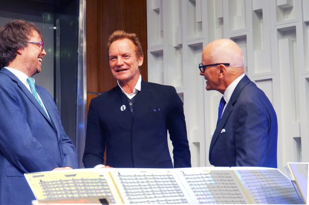 From left, John Troutman, Sting and John Gray, director of the American History Museum. (Photo by John Barrat)