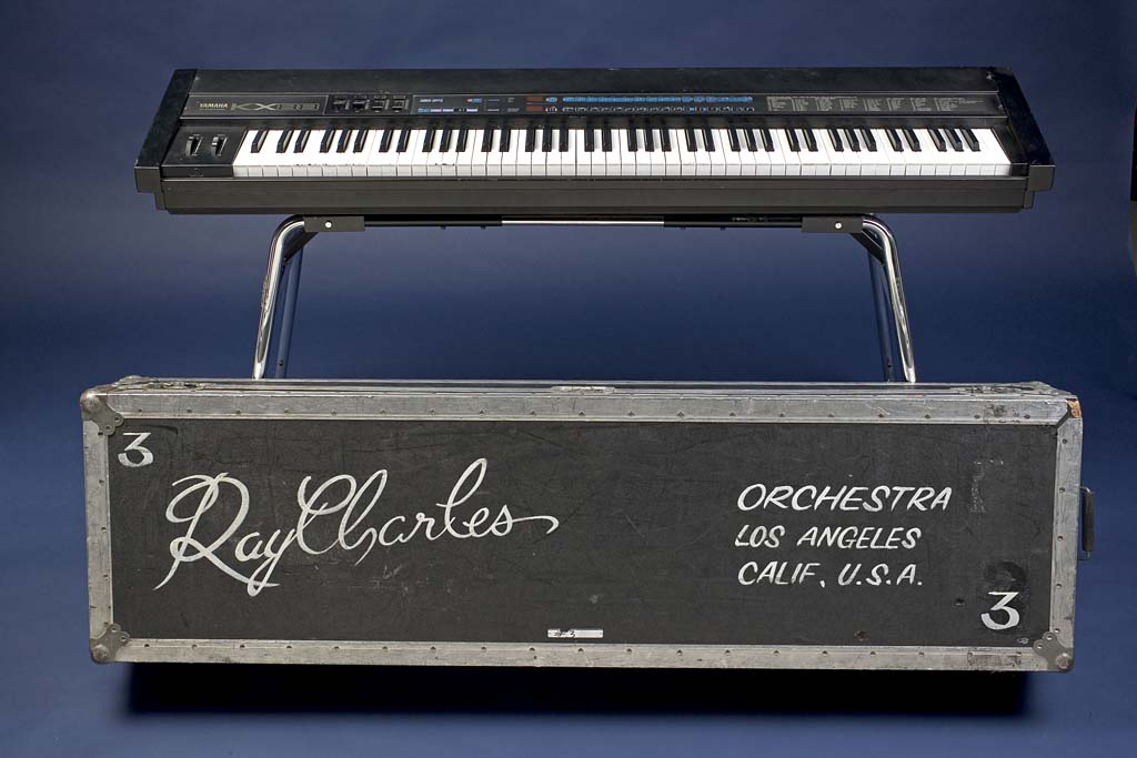 A Yamaha KX88 keyboard, owned by Ray Charles, complete with braille stickers