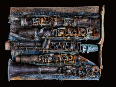 "Eric Waters photographed Dr. Michael White's damaged clarinets ""tarnished in an array of tragically beautiful colors left by water, mold, and rust"" in 2008. The images are published in Solemn Sounds of Silence: A Photographic Project of Reverence and Remembrance.© Eric Waters Photography. Photo used with permission by Eric Waters."