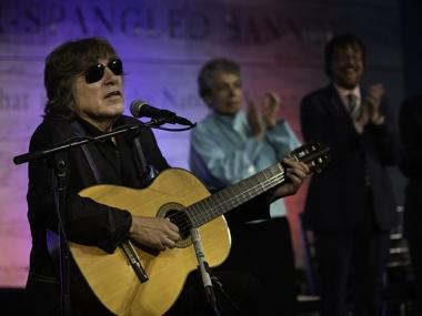 Feliciano playing guitar