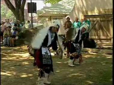 Members of the Cochiti Pueblo perform an Eagle dance at the 2000 Smithsonian Folklife Festival