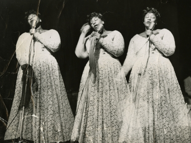 Triple-image (triple-exposure) picture of Ella Fitzgerald in concert, undated, Ella Fitzgerald Papers, ca. 1935-1996, Archives Center, National Museum of American History.