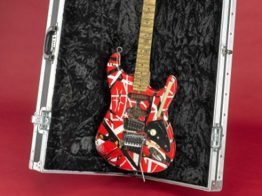 """This guitar was played by Eddie Van Halen while on tour in 2007. It is a replica of the guitar invented by Van Halen in 1977 and named """"Frankenstein"""" by fans."""