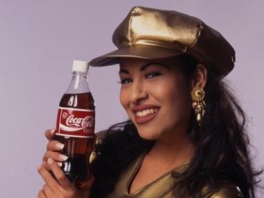 Selena holding a coke