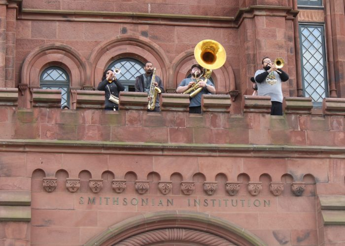 brass players on Castle portico